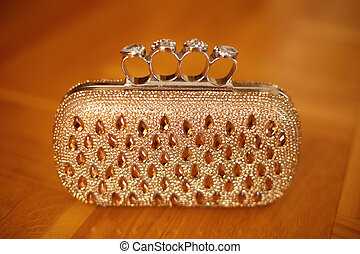 Fashion golden purse with strass and gems. Luxury womens...