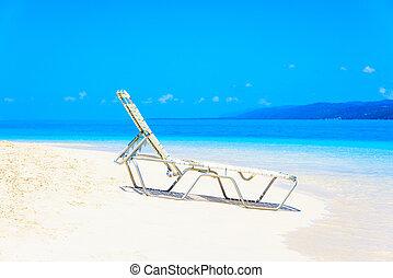 Sea beach chaise longue - White chaise lounge on the beach...