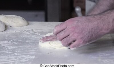 preparation of the bread dough - rolling and shaping french...