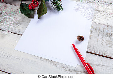 The blank sheet of paper on the wooden table with a pen and...
