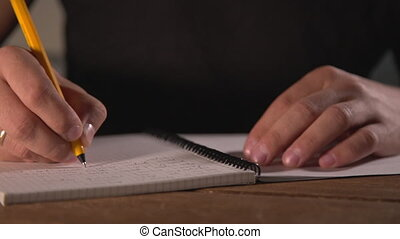 hand writing in notebook