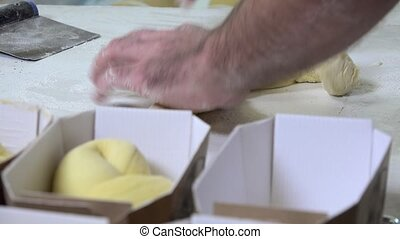 preparing french brioche - braiding brioche dough portions