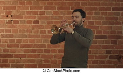 Jazz man playing his Trumpet with Road sign STOP