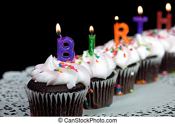 Birthday Cakes - Burning candles in cupcakes.