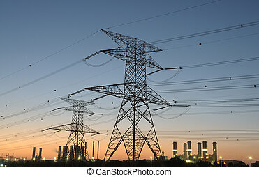 Power Pole and Electricity Station in background at sunset
