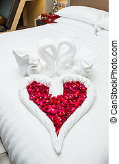 love swans and rose decoration in hotel, towel wedding...