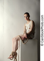 Girl with tied limbs posing as mentally ill person