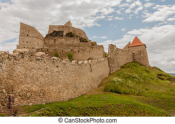 Rupea Castle, Romania-July 03, 2015: Defensive walls of a...