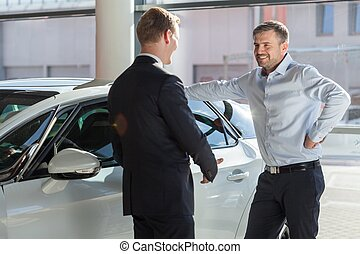 Car showroom client - Image of smiling car showroom client...