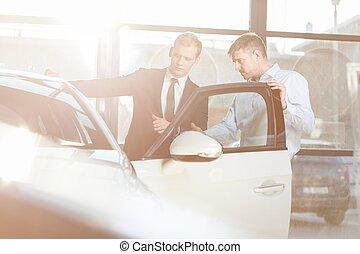 Auto salesman and customer - Photo of auto salesman and...