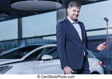 Smiling businessman buying car