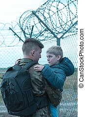 Father leaving son - Young soldier is saying goodbye to his...