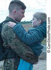 Father and son - Soldier leaving for army holds his son on...