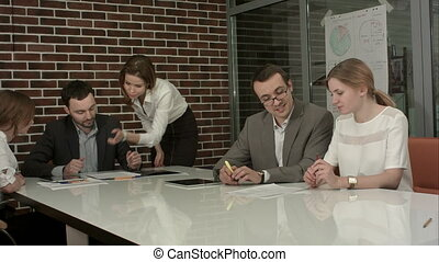 Group of business people brainstorming together in the...
