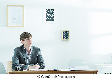 Bethinking male designer working - Photo of bethinking young...