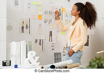 Designer working in atelier - Image of fashion designer...