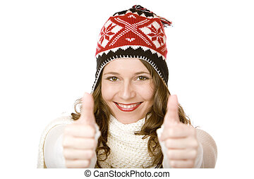 Young happy smiling woman with cap and scarf shows both thumbs up. Isolated on white.
