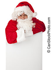 Santa Claus is leaning on a white board with space for...