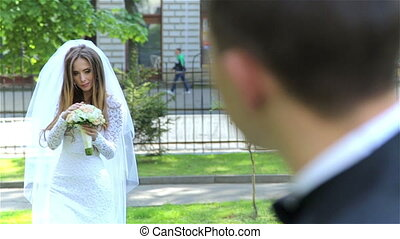 Beautiful just married couple in park HD