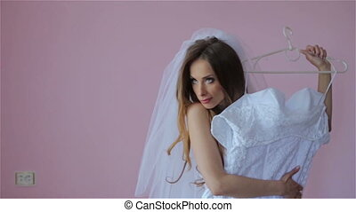 Beautiful bride tries on a wedding dress