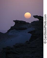 sunset in desert mountain landscape