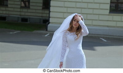 bride walking in the park wind dispels her hair - Beautiful...