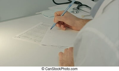Doctor sitting on the desk with paper  and working. People