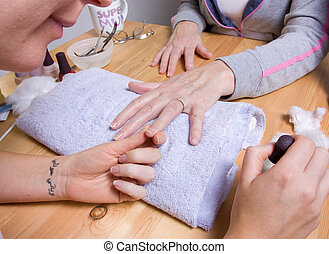 Home Manicure - Older senior woman with arthritic hands...