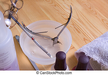 Manicure Tools - Manicurists tools soaking in bowl of...