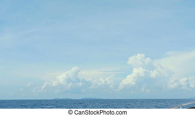 Speedboat ocean trip - Seascape with cumulus clouds high...