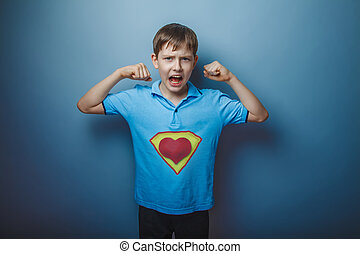 Boy superhero teenager raised his arms shouting power to...