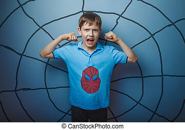 Boy superhero - Spider man superhero teen boy raised his...