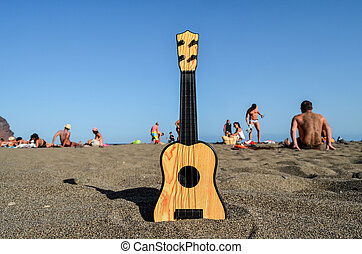 Guitar on the Sand Beach - Photo Picture of a Guitar on the...
