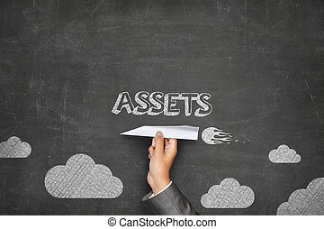 Assets concept on blackboard with paper plane - Assets...