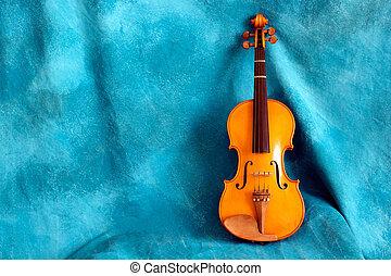 full violin aganst blue backdrop