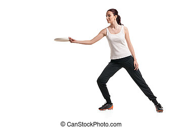 young happy woman playing frisbee over white