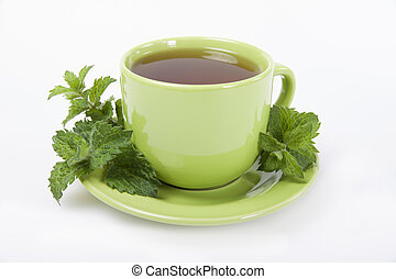 Green cup of  tea with lemon balm herb  .