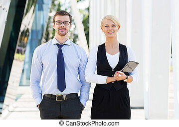 Couple of business persons - Two business colleagues going...