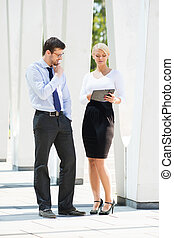 Couple of business persons - Beautiful woman and handsome...