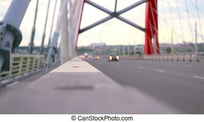 Road through the bridge with cloudy sky and moving cars. Changes focus from blurred and bokeh