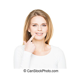 Attractive teenage girl smiling in dental braces. Stomatology concept.