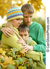 sad Mother with her sons in autumn park