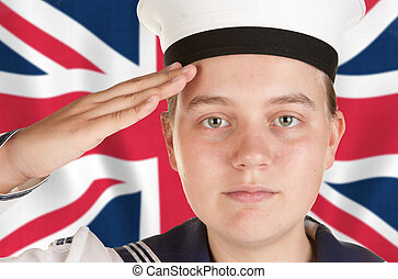 young sailor saluting in front of union jack - young female...