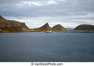 Fish Farm at the Porsangerfjord, Norway - Fish farming at...