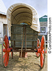 Old wagon - An antique horse-drawn wagon near a barn at a...