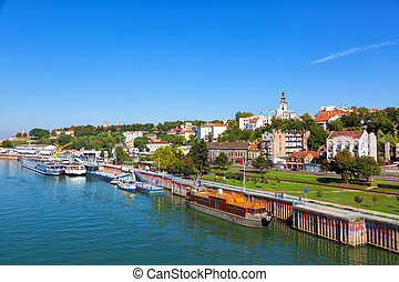 Belgrade from river Sava with tourist riverboats on a sunny...