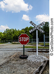 Stop Sign at Railroad Crossing
