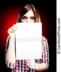 Surprised young girl holding exercise book - Surprised young...