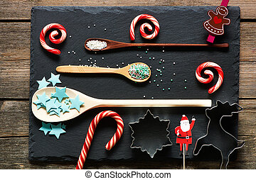 Sugar sprinkle dots on and candies slate background