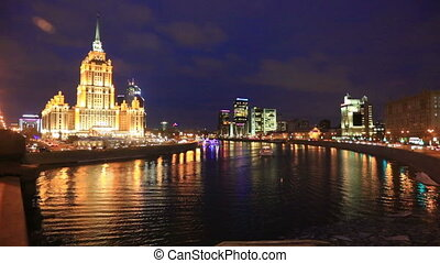 Illuminated building of Hotel Ukraina and Moscow river at...